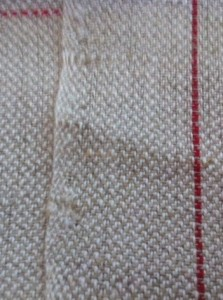Handmade linen tea towel. Detail from the selvage.
